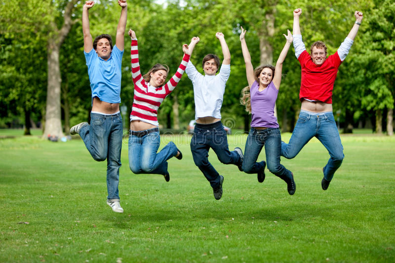 Download Friends jumping outdoors stock image. Image of successful - 12836077