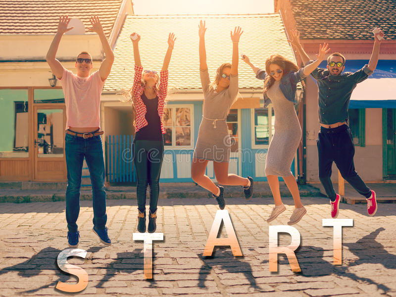 Friends jumping at sunny day with text start stock photography