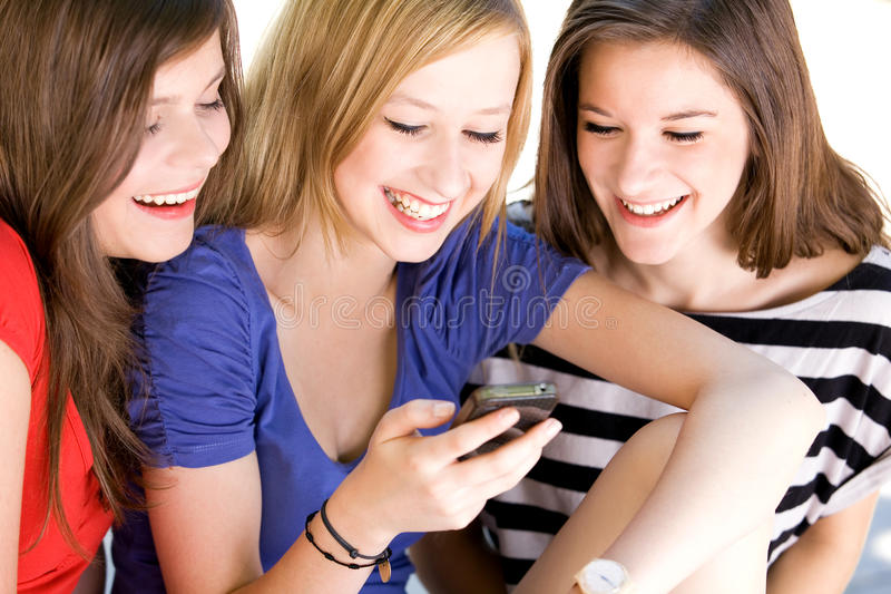 Friends Looking On Cellphone Stock Photography