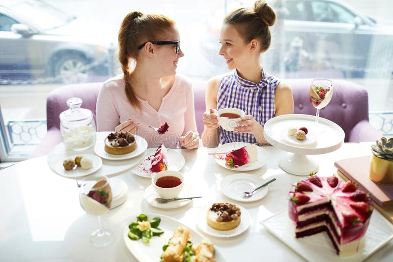 Friends looking at each other in cafe royalty free stock images