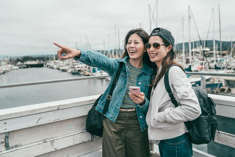 Friends looking at where a girl pointing to royalty free stock photo