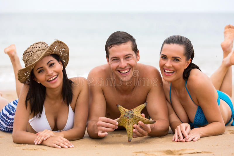 Friends lying beach stock photo