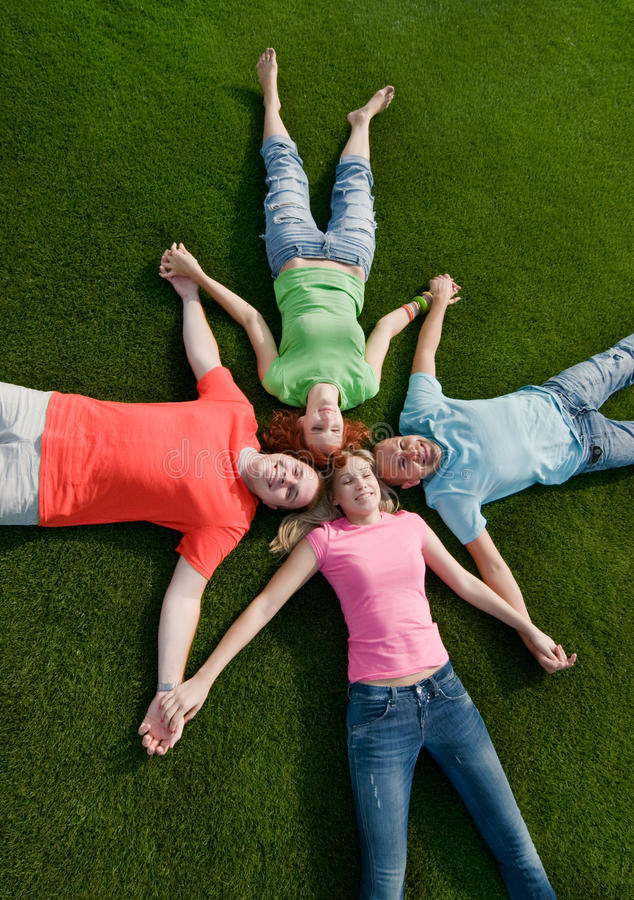 Free Friends Lying On Grass Royalty Free Stock Photography - 11793087