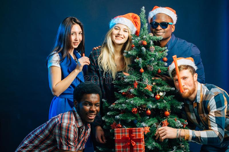 Friends makes fun on Christmas holyday with christmas tree royalty free stock images