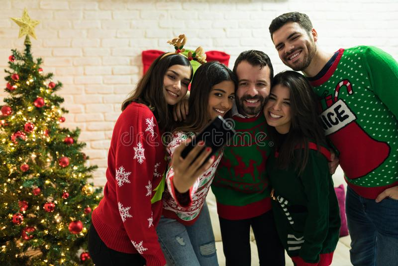Friends Making Memories While Enjoying Christmas At Home royalty free stock photo