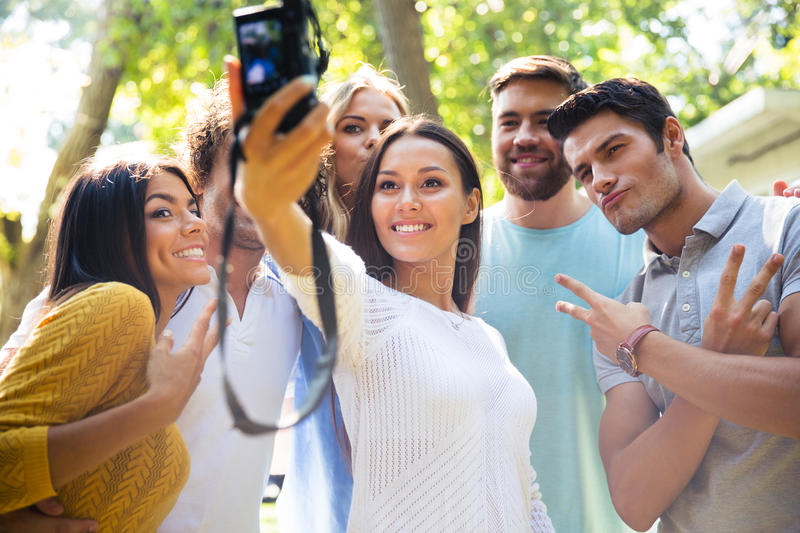 Friends making selfie photo on camera stock photo