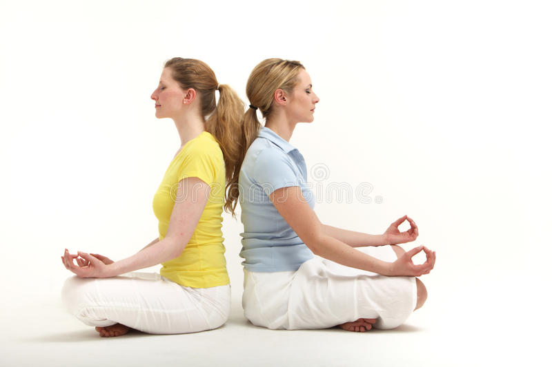 Friends Meditating Together Stock Photo