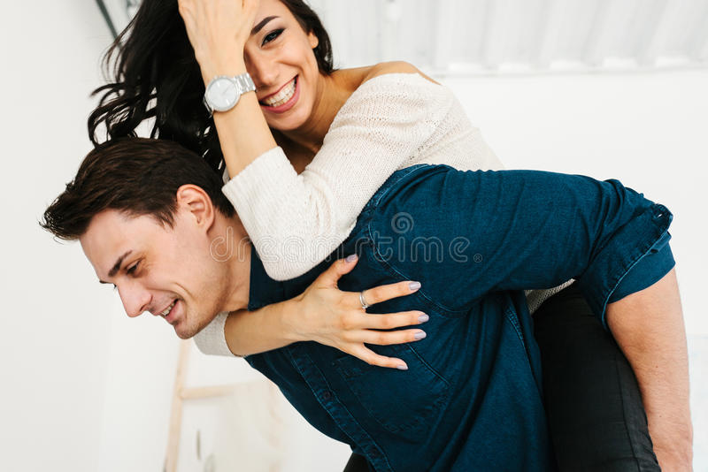 Friends of a man and a woman having fun. Friendship, rest, time together, fool around. Friends of a men and a women having fun. Friendship, time together, fool royalty free stock image