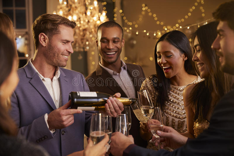 Download Friends Open Champagne As They Celebrate At Party Together Stock Image - Image: 91321035