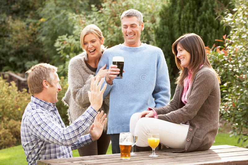 Download Friends Outdoors Enjoying Drink In Pub Garden Stock Image - Image: 13674171