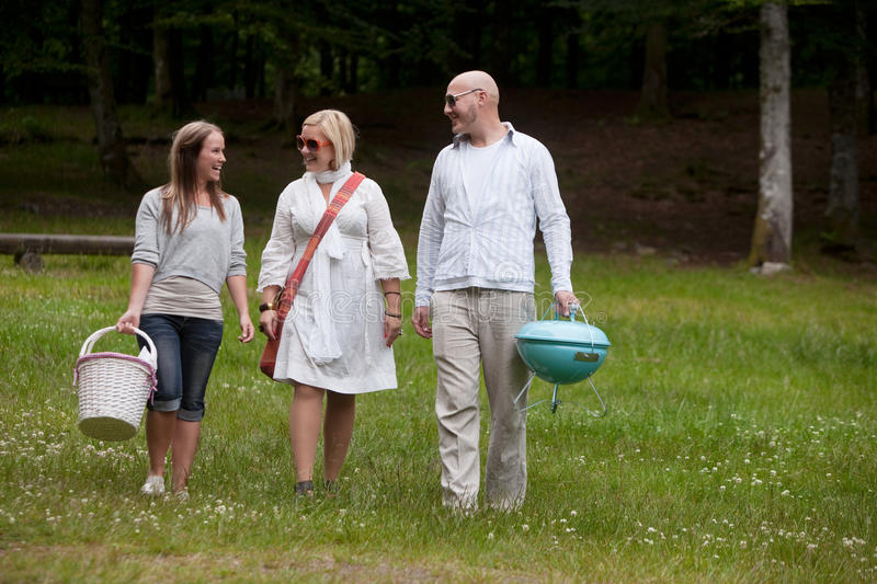 Friends in Park Ready for BBQ royalty free stock image
