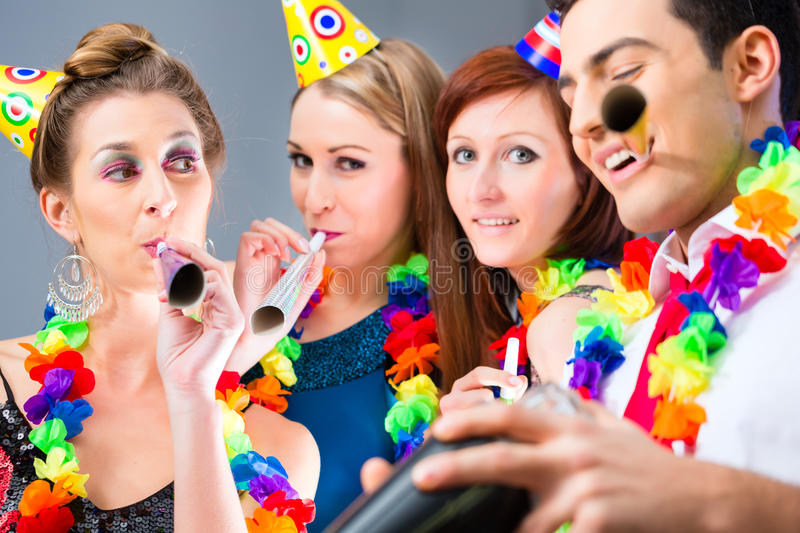 Friends partying in cocktail bar with hats. And music stock images