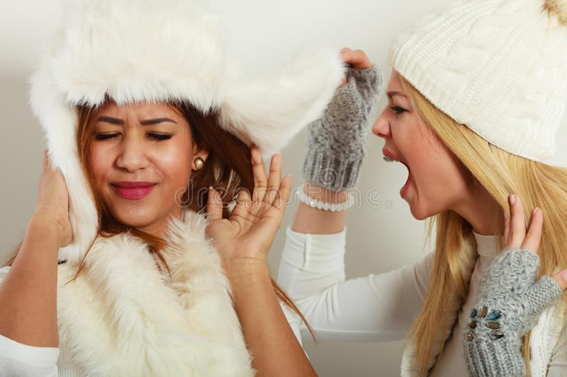 Blonde woman screaming on her friend royalty free stock image