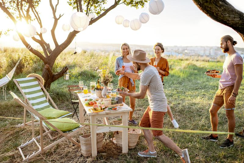 Friends on a picnic in the garden stock image