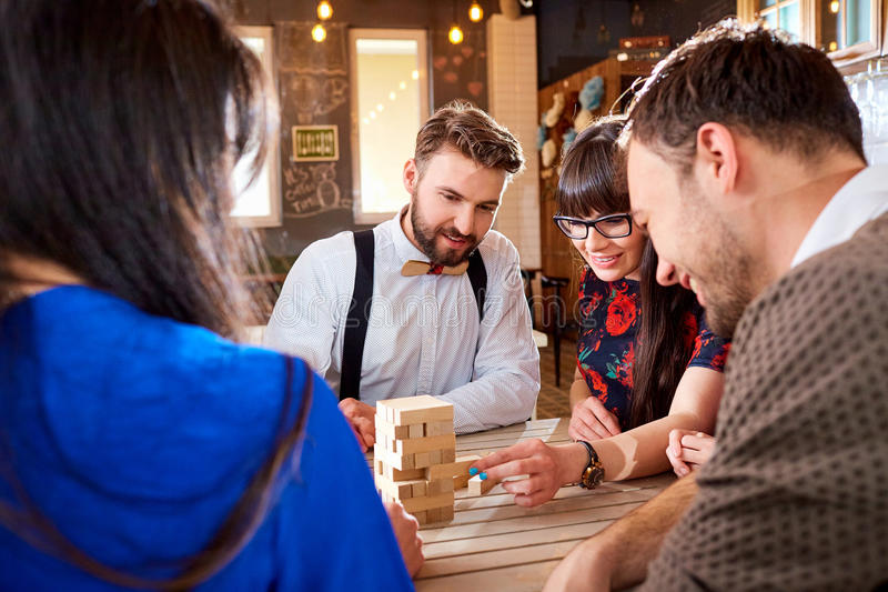 Friends play board games at the table stock photo