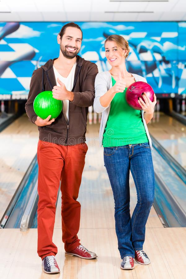 Friends playing Bowling. At bowling royalty free stock images