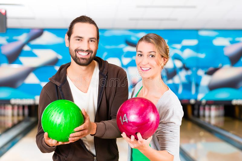 Friends playing Bowling. At bowling center stock image