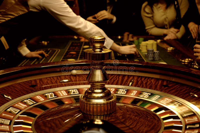 Friends playing in casino stock photo