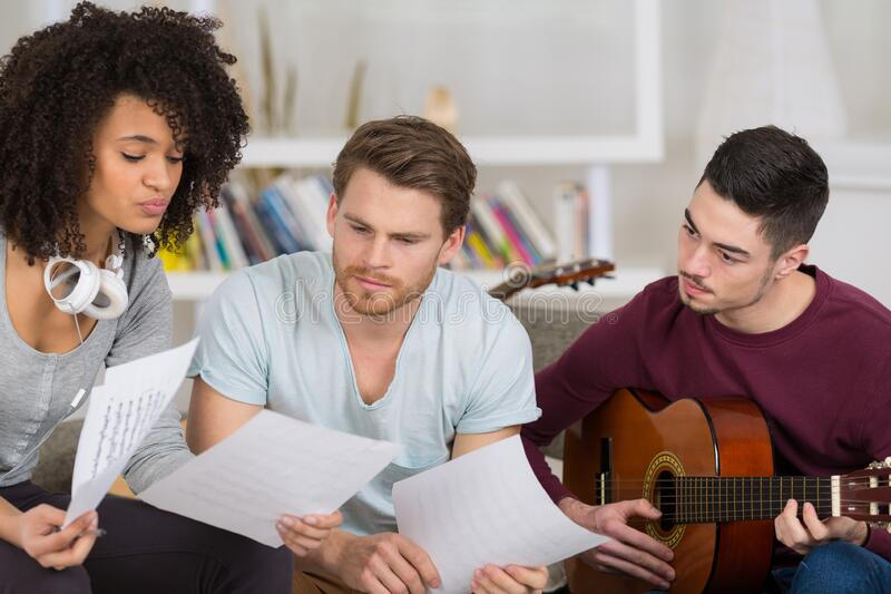 Friends playing electric guitar piano and singing royalty free stock photos