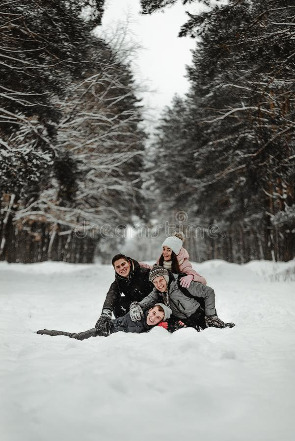 Friends playing with snow in park royalty free stock photos