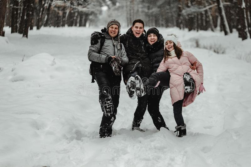 Friends playing with snow in park stock photo