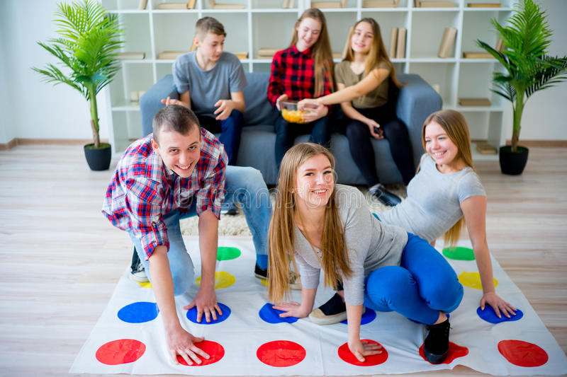 Friends playing twister royalty free stock photography