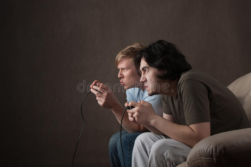 Friends playing video games royalty free stock photo