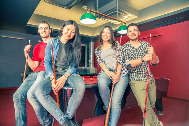 Friends at pool table royalty free stock image