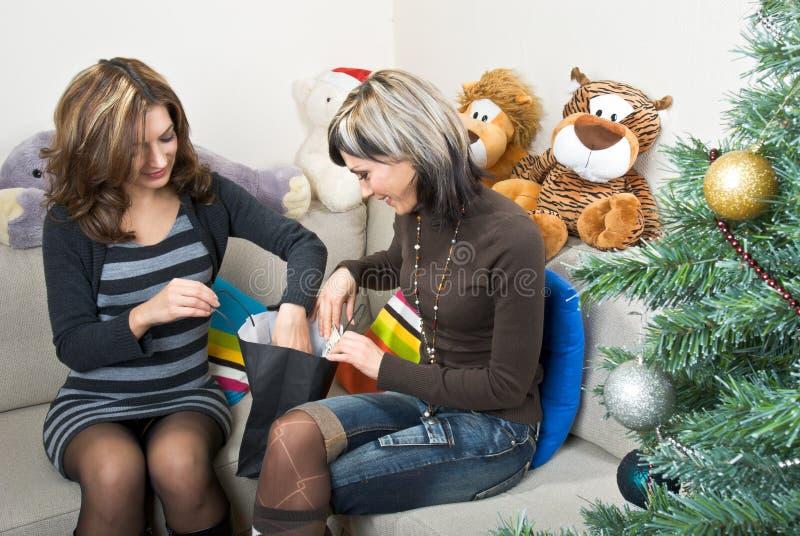 Friends Preparing Christmas Presents stock photo