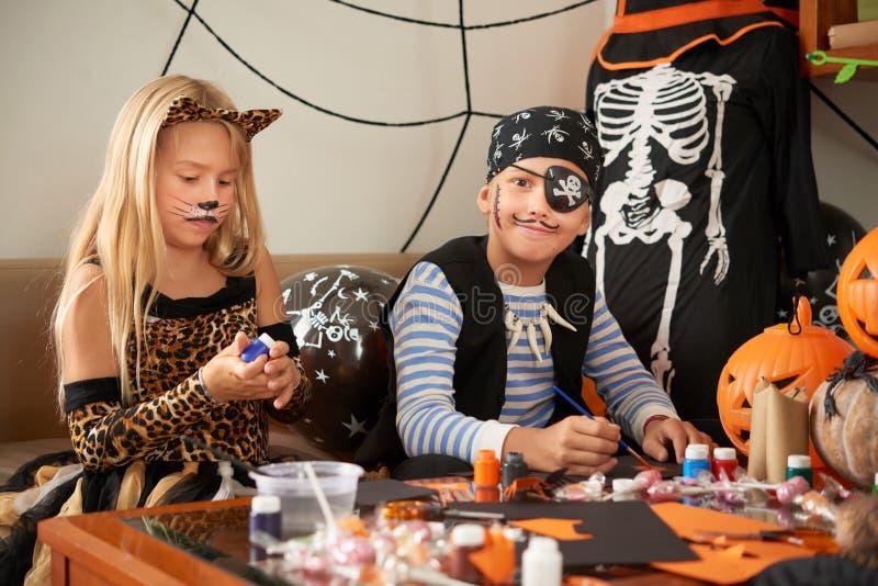 Friends preparing for Halloween stock image