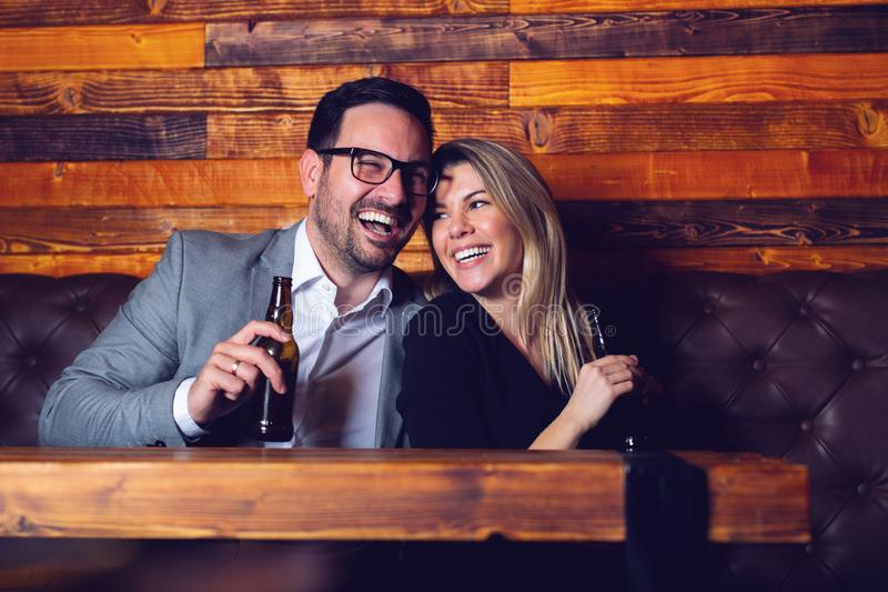 Friends in the Pub. Drinking beer, talking, having fun. stock photography