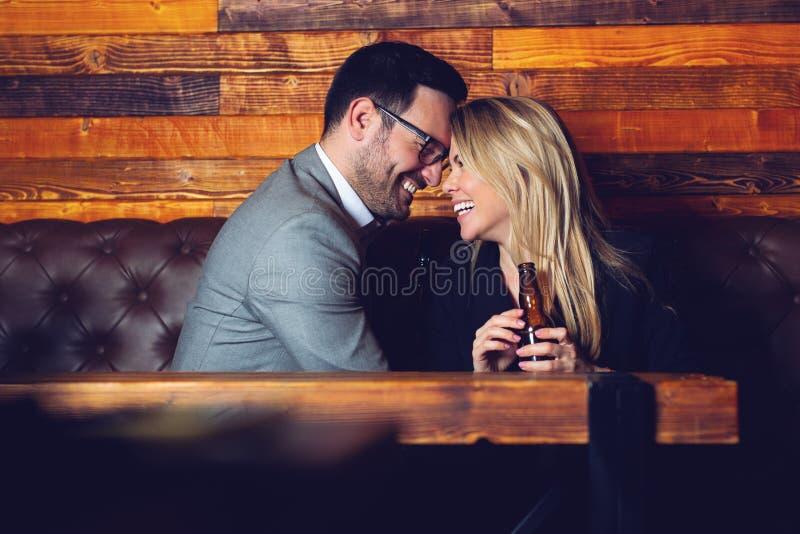 Friends in the Pub. Drinking beer, talking, having fun. stock photo