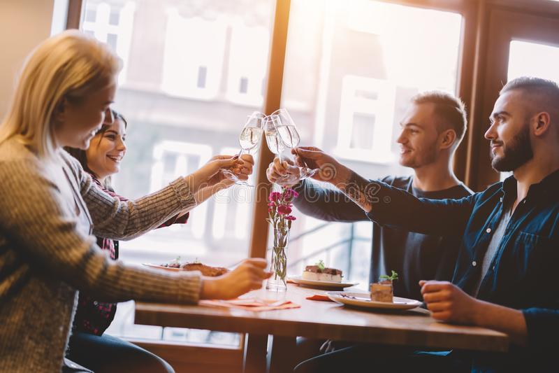 Friends toasting in a restaurant, celebrating. stock image