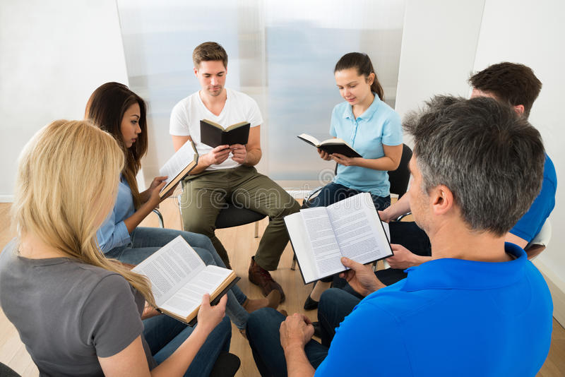 Friends reading bible royalty free stock photo