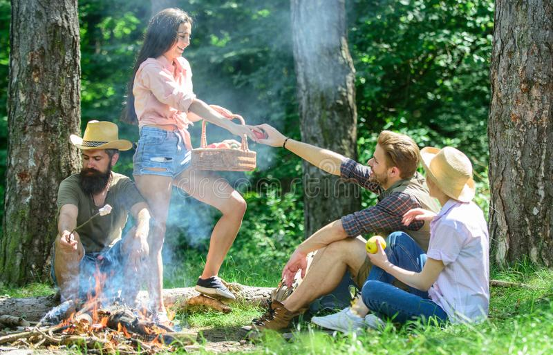 Friends relaxing near bonfire. Friends enjoy vacation or leisure nature forest background. Plan for perfect day hike. Picnic. Pleasant hike picnic in forest stock images