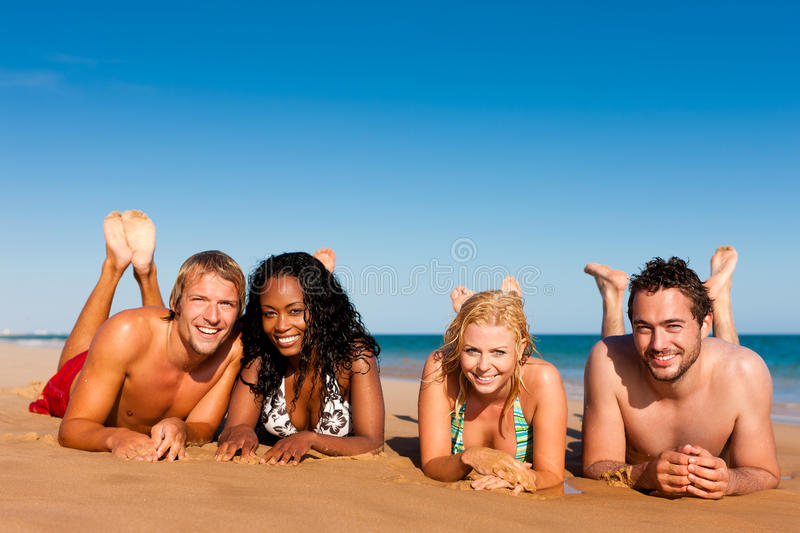 Friends running on beach vacation stock images