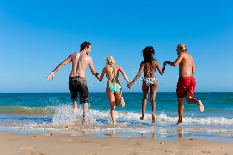 Download Friends Running On Beach Vacation Royalty Free Stock Photo - Image: 18235845