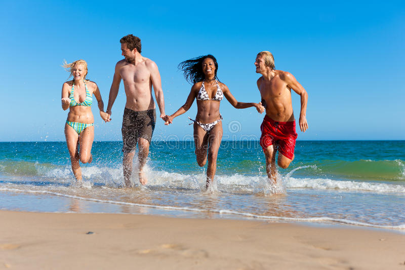Download Friends Running On Beach Vacation Stock Image - Image: 18235901