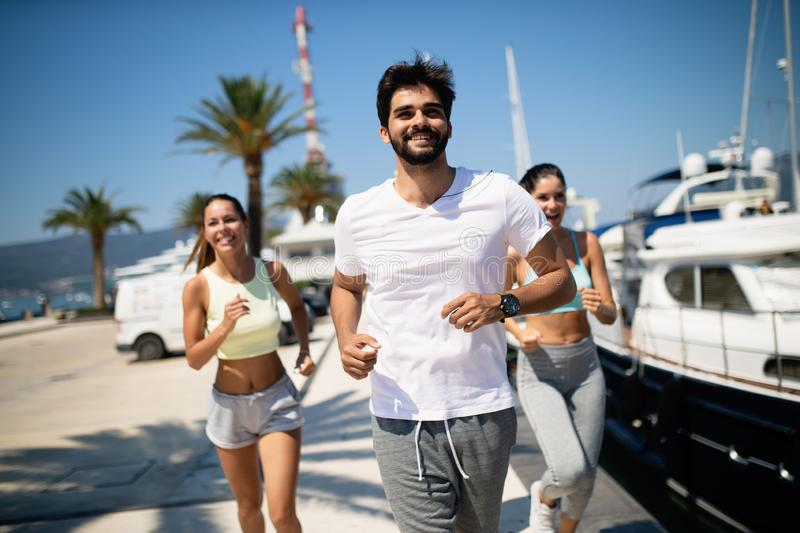 Friends running fitness training together outdoors living active healthy royalty free stock photos
