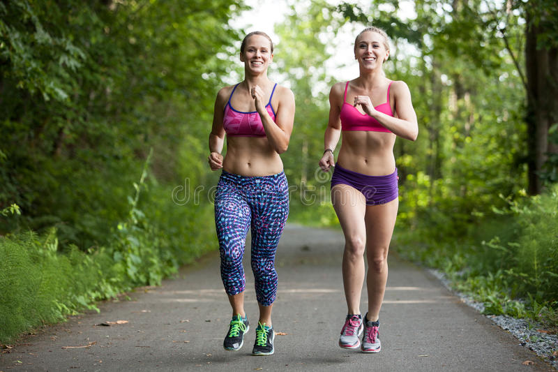 Friends running together royalty free stock image