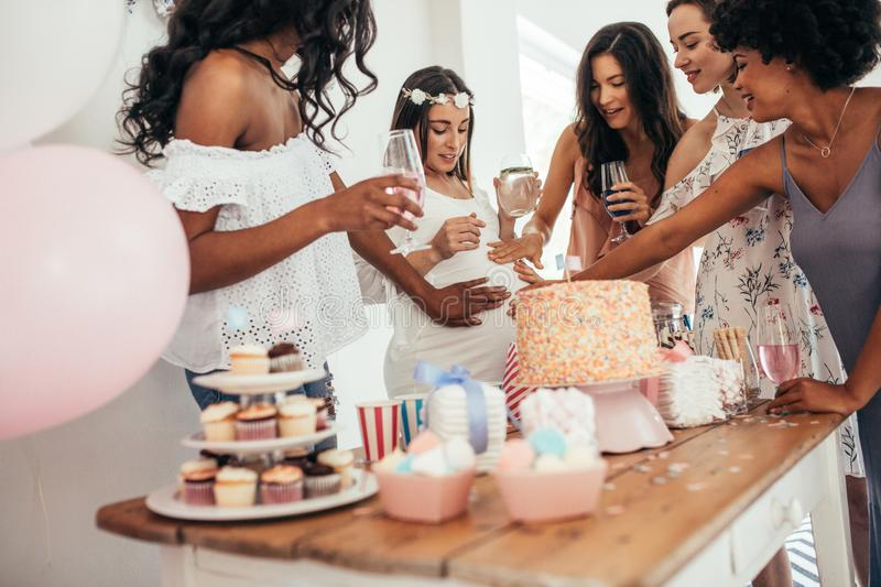 Friends sharing love and support to pregnant woman royalty free stock photo