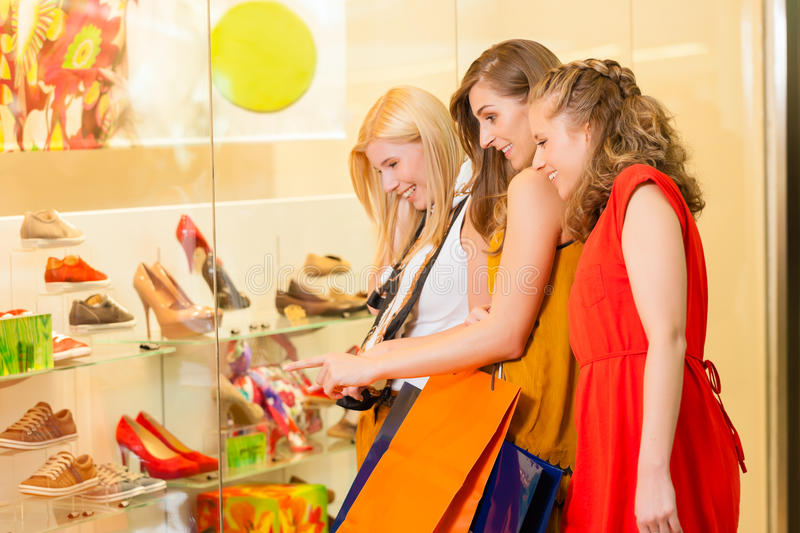 Download Friends Shoe Shopping In A Mall Royalty Free Stock Photos - Image: 25406008
