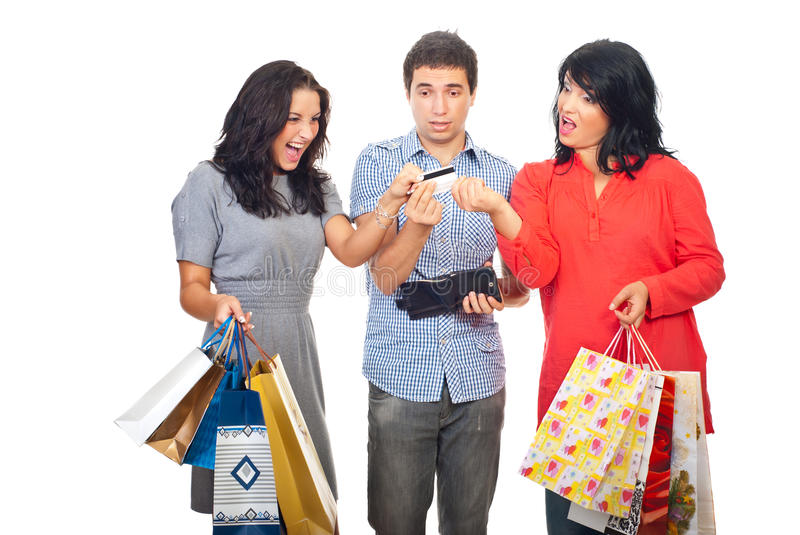 Friends at shopping fight for credit card stock photography