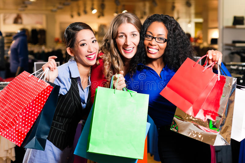 Download Friends Shopping With Presents In Mall Stock Photo - Image: 18542982