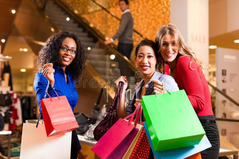 Download Friends Shopping With Presents In Mall Stock Photo - Image: 18543062