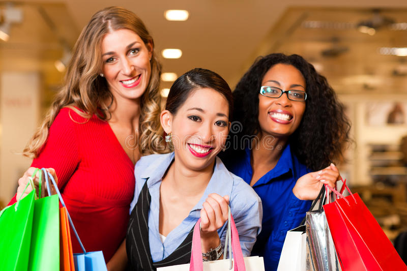 Download Friends Shopping With Presents In Mall Stock Photo - Image: 18543112