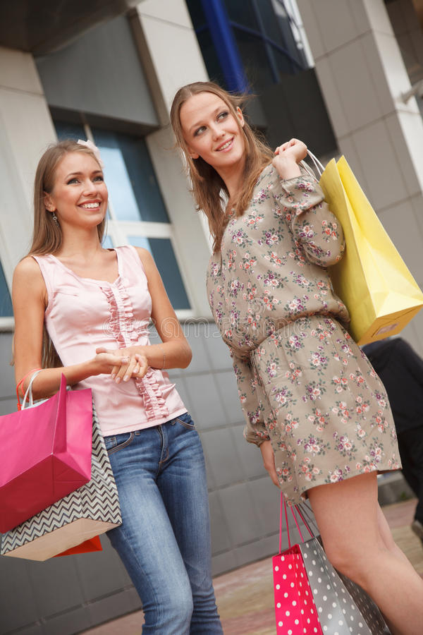 Friends shopping stock photos