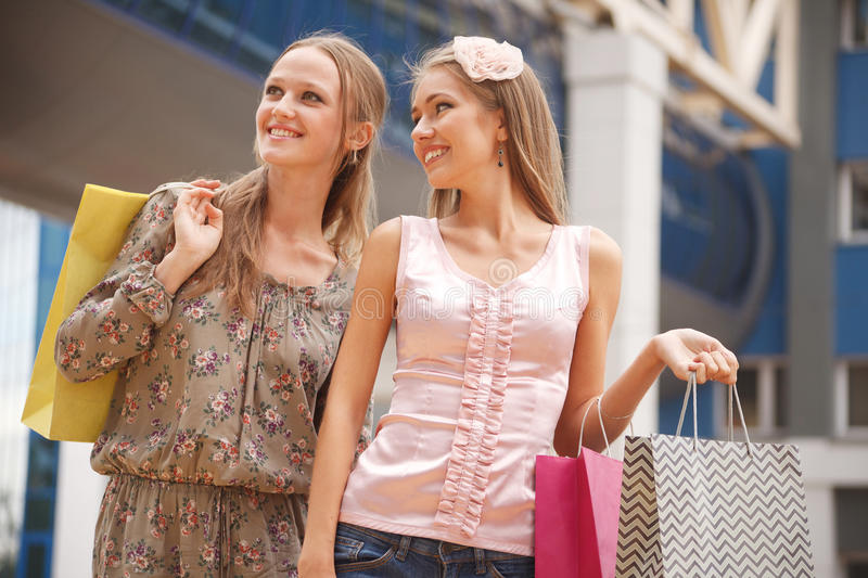 Friends shopping stock images