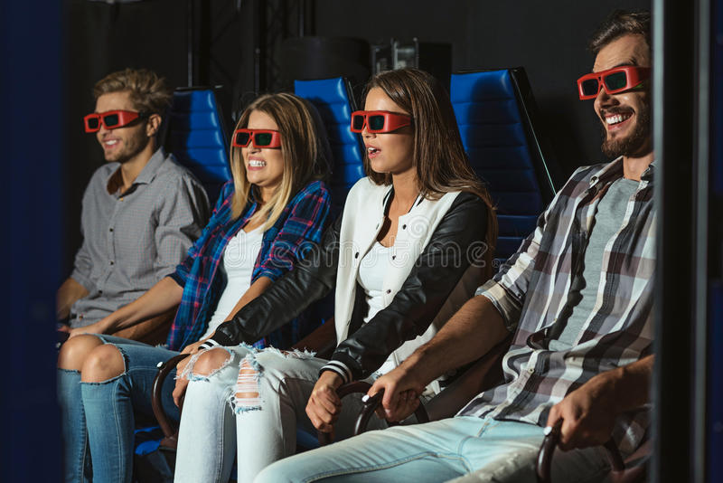 Friends sitting in 3D glasses royalty free stock photos