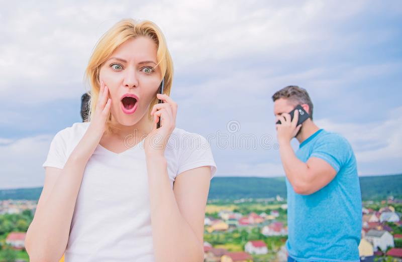 Friends and smartphone. Friends on phone. Talking with friends. stock photo